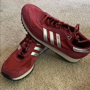 Red adidas sneakers.